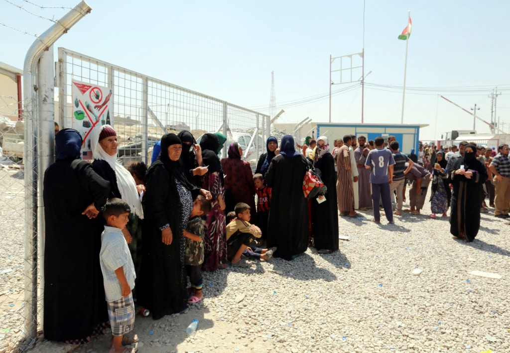 epa05438164 Iraqi displaced people who fled from areas near Mosul wait in the queue to get aid at Dibaga camp, ouskirts of Mosul, southwest of Erbil, the capital of Kurdistan region, north of Iraq, 23 July 2016. According to local official, at least Ten thousand people arrived to Dibaga camp during the last three days due to the fighting between the Iraqi forces and Islamic State (IS) terror militia near Mosul city, which hosted around two million people before it fell to Islamic state group (IS) in June 2014. More than three million people have been forced to flee their homes in Iraq since January 2014, according to the United Nations. EPA/AHMED JALIL