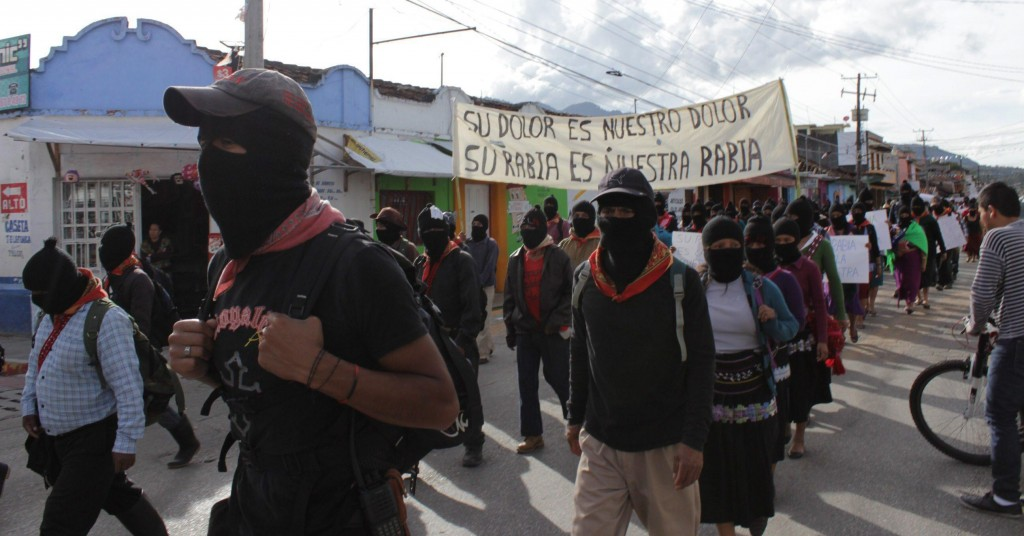epa04437773 Members of the Ejercito Zapatista de Liberacion Nacional (EZLN, Zapatista Army of National Liberation) march in support of 43 missing students, which vanished in Iguala municipality, in San Cristobal de las Casas, Chiapas, Mexico, 08 October 2014. Thousands of Mexicans demanded from the Government to intensify the search for the students, who dissapeared on 26 September 2014, after they were detained by Iguala policemen. EPA/Miguel Abarca