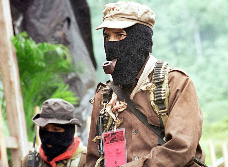 (FILES) Picture dated 22 February 1996 of Deputy Commander Marcos (C) and a member of the Zapatista Army of National Liberation (EZLN). EZLN members will celebrate next January 1st 2004, the 20th anniversary of their founders departure to the forest for the training and consolidation of the forces that eventually shaped the EZLN. EPA/Jorge N˙Òez