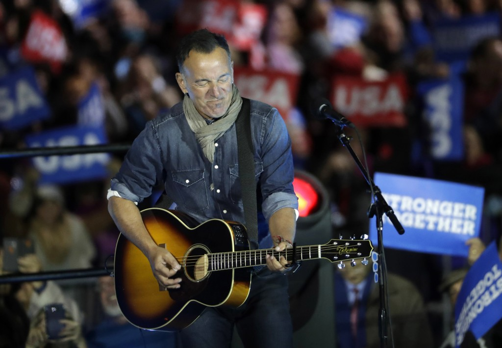 Bruce Springsteen performs during a Hillary Clinton campaign event at Independence Mall on Monday, Nov. 7, 2016 in Philadelphia. (AP Photo/Matt Slocum)