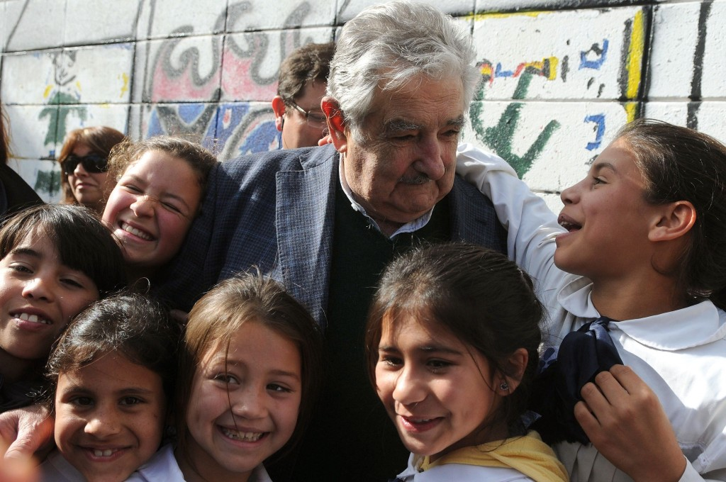 MONTEVIDEO, Oct. 2, 2013 Uruguayan President Jose Mujica (C) speaks to a student during the handing over ceremony of computer number one million of the Ceibal Plan, a literacy project created 6 years ago inspired by the ''One Laptop per Child'' project, in Montevideo, capital of Uruguay, on Oct. 2, 2013. (Credit Image: © [E]Nicolas Celaya/Xinhua/ZUMAPRESS.com)