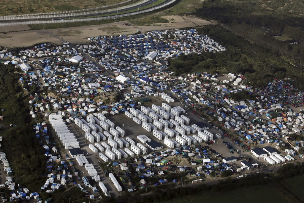 2016 AP YEAR END PHOTOS - An aerial view shows a makeshift migrant camp near Calais, France, on Oct. 17, 2016. The French evacuated 6,400 migrants from the encampment in 170 buses, starting on Oct. 24, 2016, with the intent of resettling the migrants in different regions of France. On Oct. 26 French authorities announced that the camp had been cleared. (AP Photo/Thibault Camus, File)