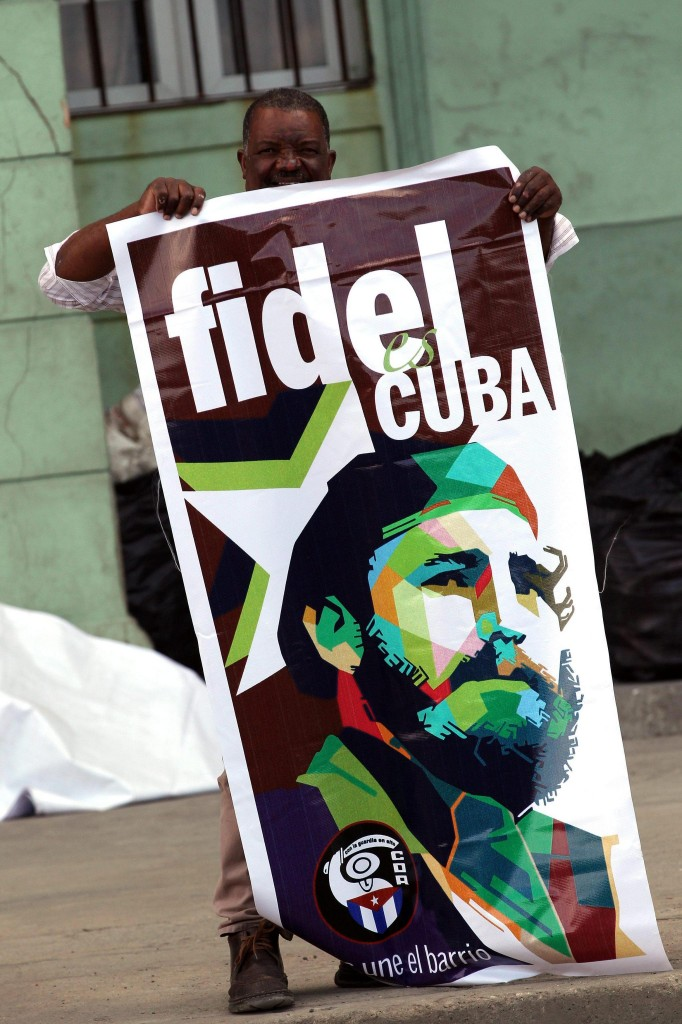 epa05650182 A man shows a poster with the image of late Cuban leader Fidel Castro in Havana, Cuba, 27 November 2016. Cuba begins the second of nine days of official mourning decreed by the Government for the death of former President Fidel Castro, with the main acts of homage to begin on 28 November and continue until 04 December 2016. EPA/Alejandro Ernesto