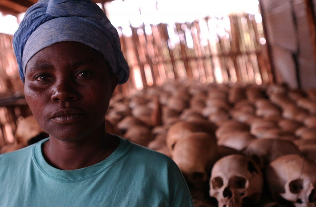 epa04156389 (FILE) A undated file photo shows Dancila Nyirabazungu, a survivor and one of curators of the genocide memorial at Queen of the Apostles Church of Ntarama, in front of hundreds of skulls on display where some 5,000 people were killed during the genocide of 1994. On Monday, 07 April 2014 leaders including UN Secretary General Ban Ki-moon will gather in Kigali, Rwanda, to remember the events in 1994, when around 800,000 Rwandans were brutally killed in a three-month campaign by the Hutu-led government against the Tutsi population. EPA/STEPHEN MORRISON