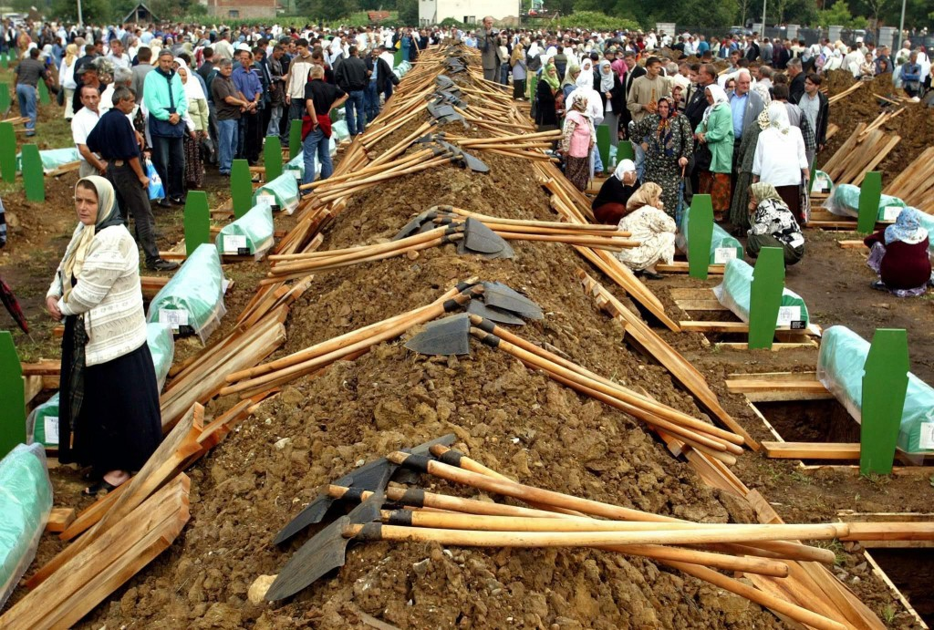 epa04766957 (FILE) A file picture dated 11 July 2003 shows people attending the burial of 282 Bosnian Muslim men on the eighth anniversary of the Srebrenica Massacre, in the eastern Bosnian Serb town of Srebrenica. July 2015 marks the 20-year anniversary of the Srebrenica Massacre that saw more than 8,000 Bosniak men and boys killed by Bosnian Serb forces during the Bosnian war. EPA/FEHIM DEMIR PLEASE REFER TO THIS ADVISORY NOTICE (epa04766937) FOR FULL PACKAGE TEXT