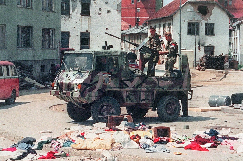 epa04766941 (FILE) A file picture dated 16 July 1995 showing a Bosnian Serb armed vehicle crew driving through the empty streets of Srebrenica after the Bosnian Serb army took the UN safe area one week before. July 2015 marks the 20-year anniversary of the Srebrenica Massacre that saw more than 8,000 Bosniak men and boys killed by Bosnian Serb forces during the Bosnian war. EPA/IGOR DUTINA PLEASE REFER TO THIS ADVISORY NOTICE (epa04766937) FOR FULL PACKAGE TEXT
